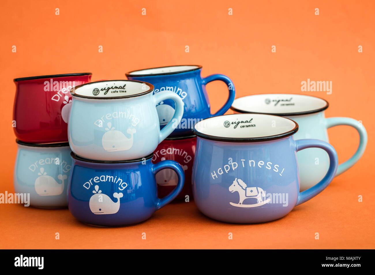 Creative Cute Coffee Mugs On Orange Background Stock Photo Alamy