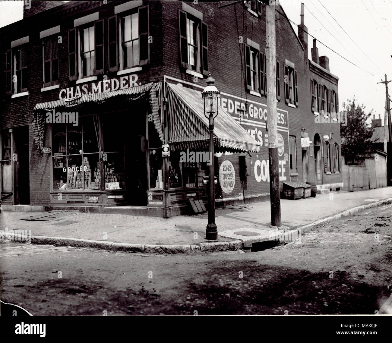 Title: Charles Meder Grocery store at the corner of Nineteenth and Dodier Streets.  . circa 1900. - Stock Image