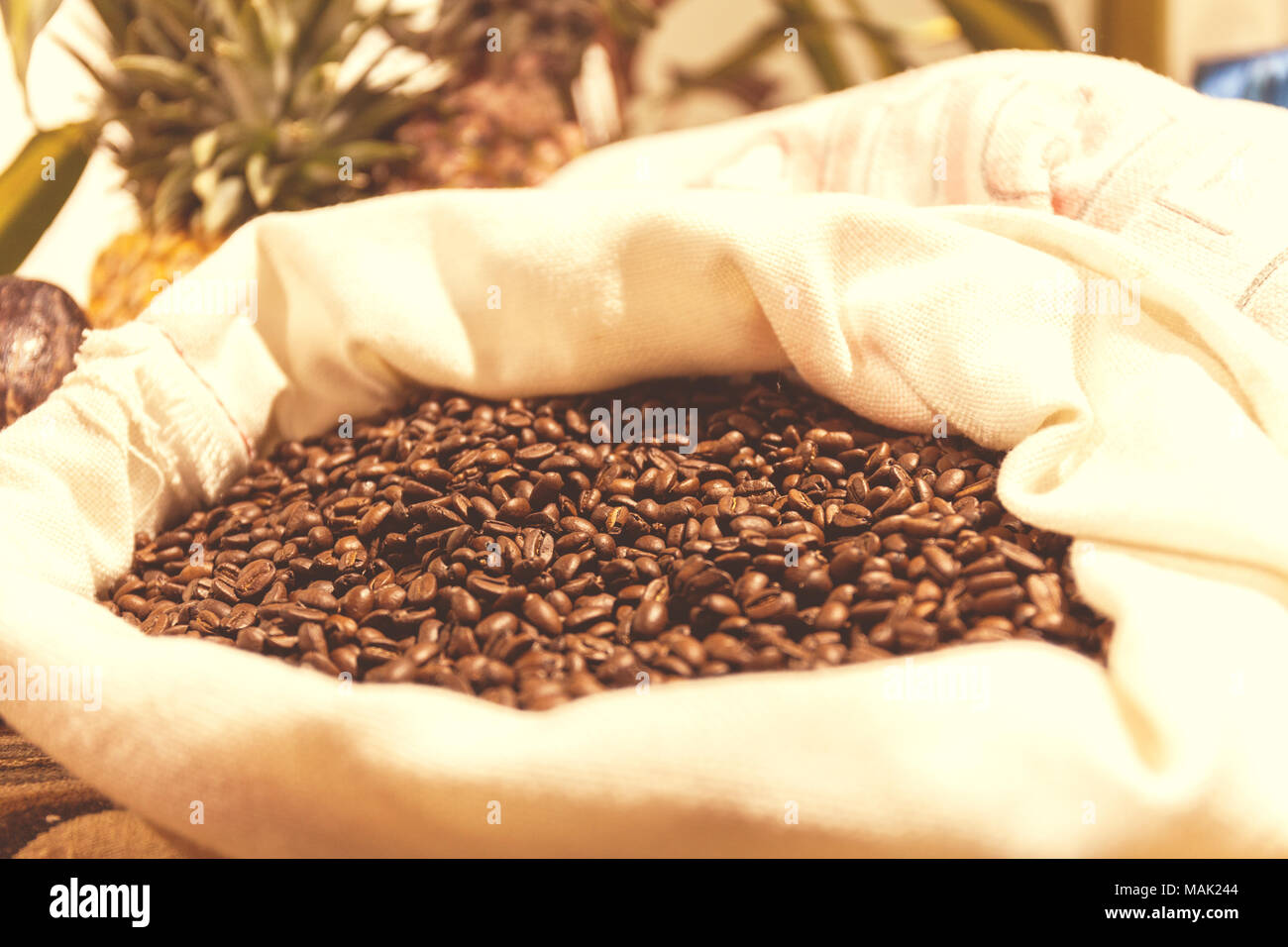 bag of roasted coffee beans on the market in South America. Vintage Toning Effect - Stock Image
