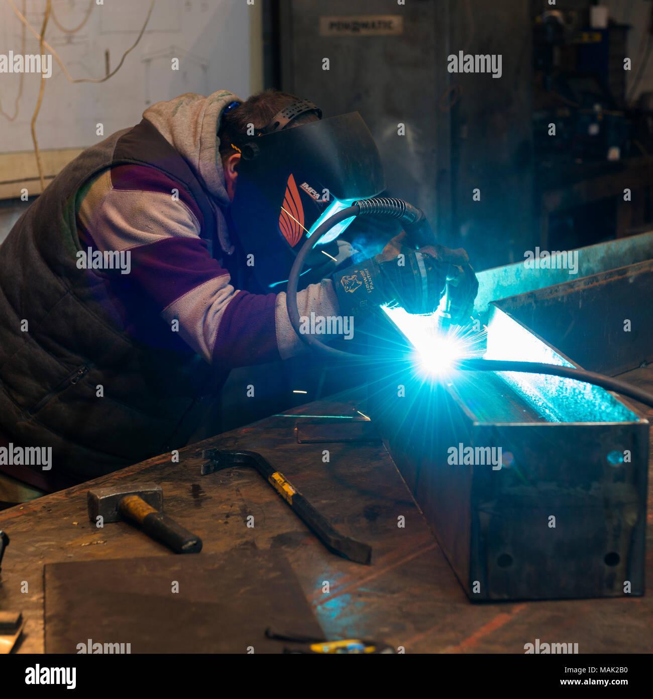 Welder arc welding steel frame Stock Photo