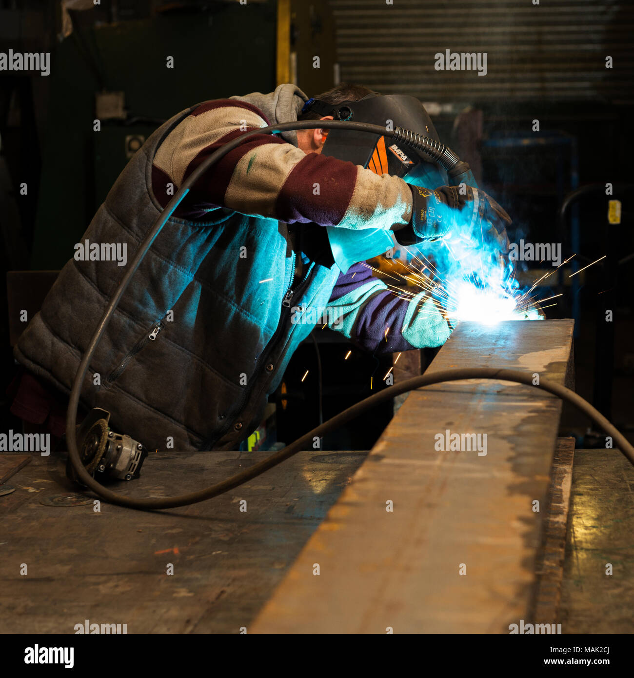 Welder arc welding steel frame Stock Photo