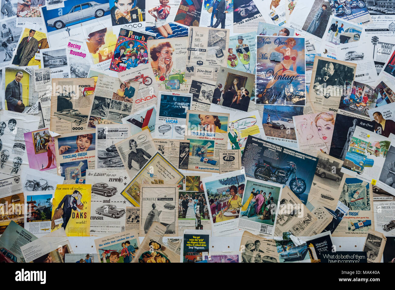 Various vintage magazine adverts on a wall in Coventry Market, Coventry, West Midlands, UK. - Stock Image