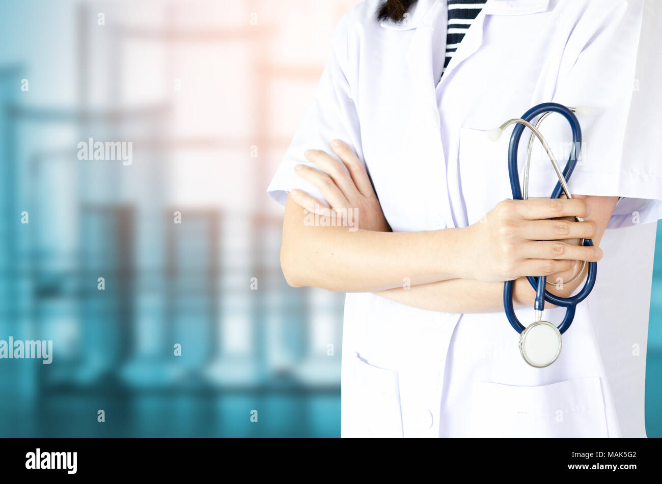 Medical physician doctor woman over blue clinic background