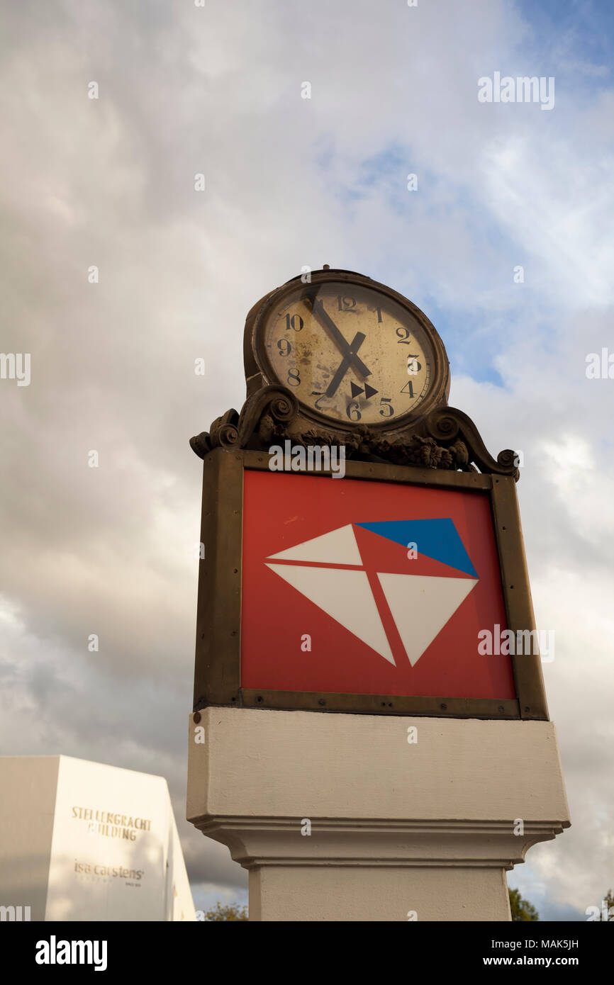 The clock and post office sign on a raised pedestal outside the old post office building in Stellenbosch. - Stock Image