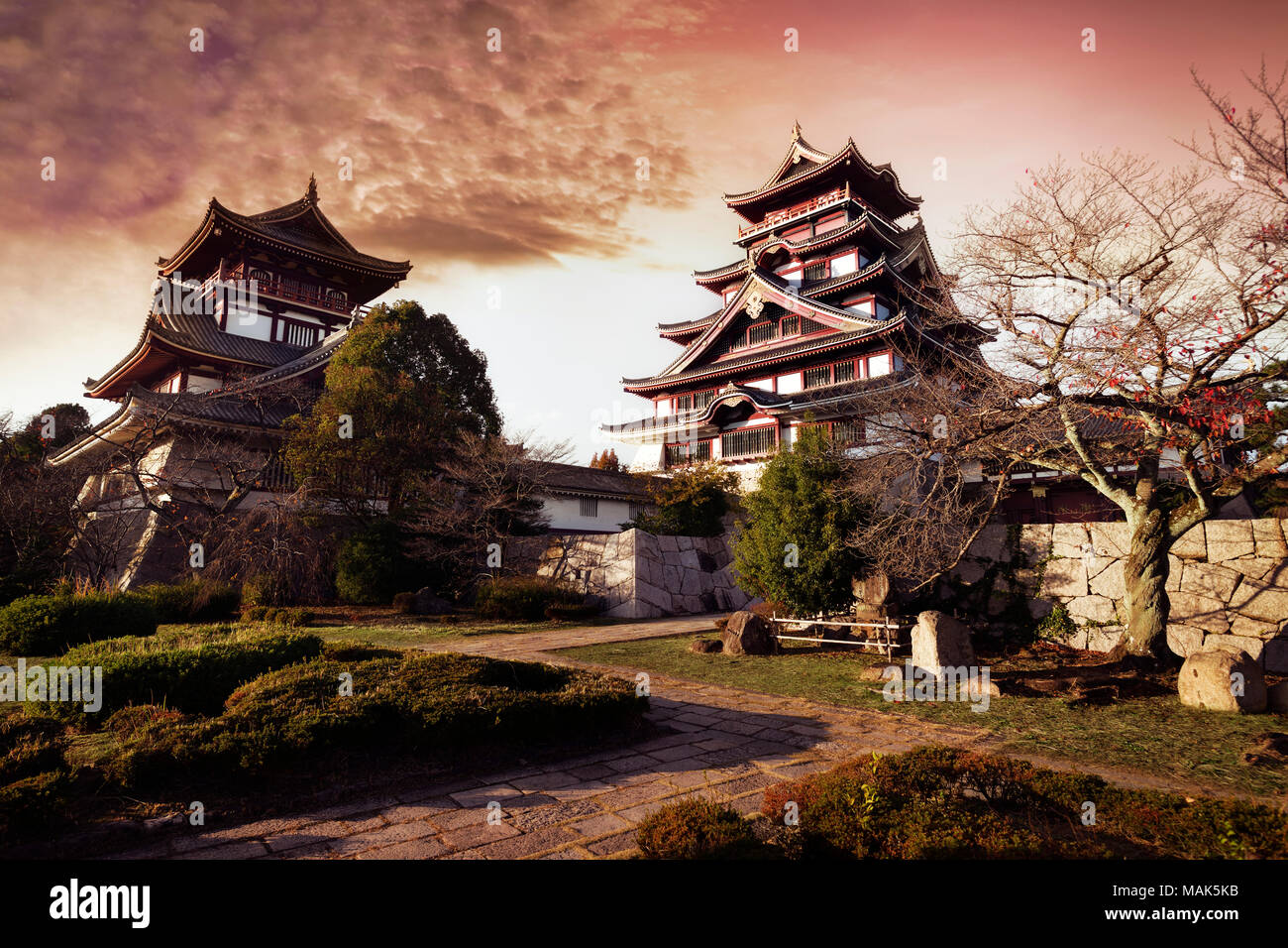 Fushimi Castle, Fushimi-jo in Kyoto, also known as Fushimi-Momoyama Castle or Momoyama Castle famous for its golden tea room. Colorful red sunset autu Stock Photo