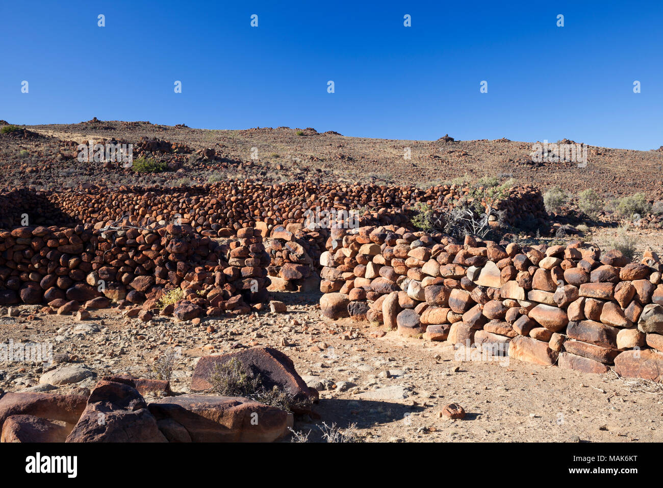 Stone walls of an old kraal or livestock pen in the Karoo, South Africa. - Stock Image