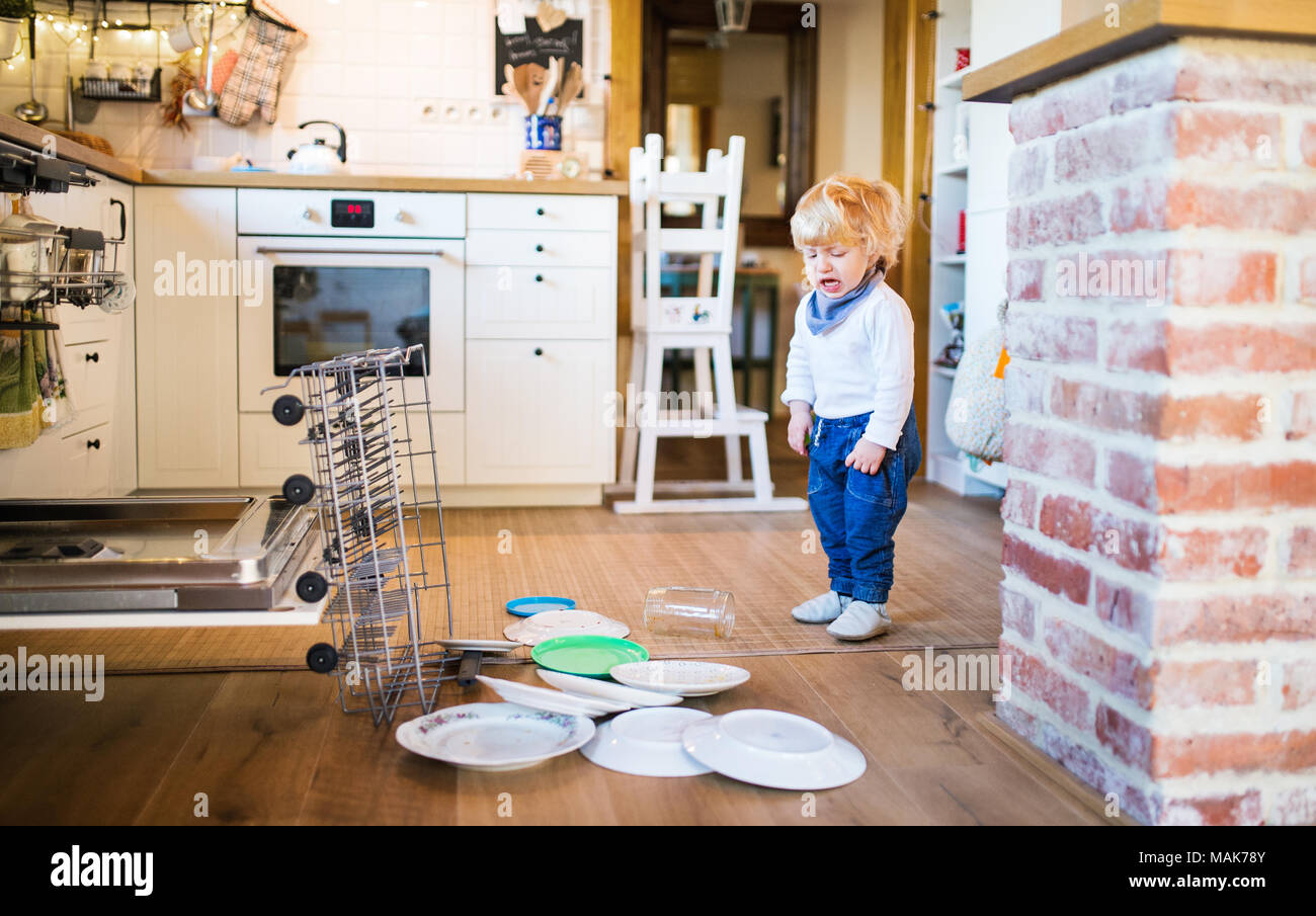 Toddler Boy In Dangerous Situation At Home Child Safety Concept Stock Photo Alamy