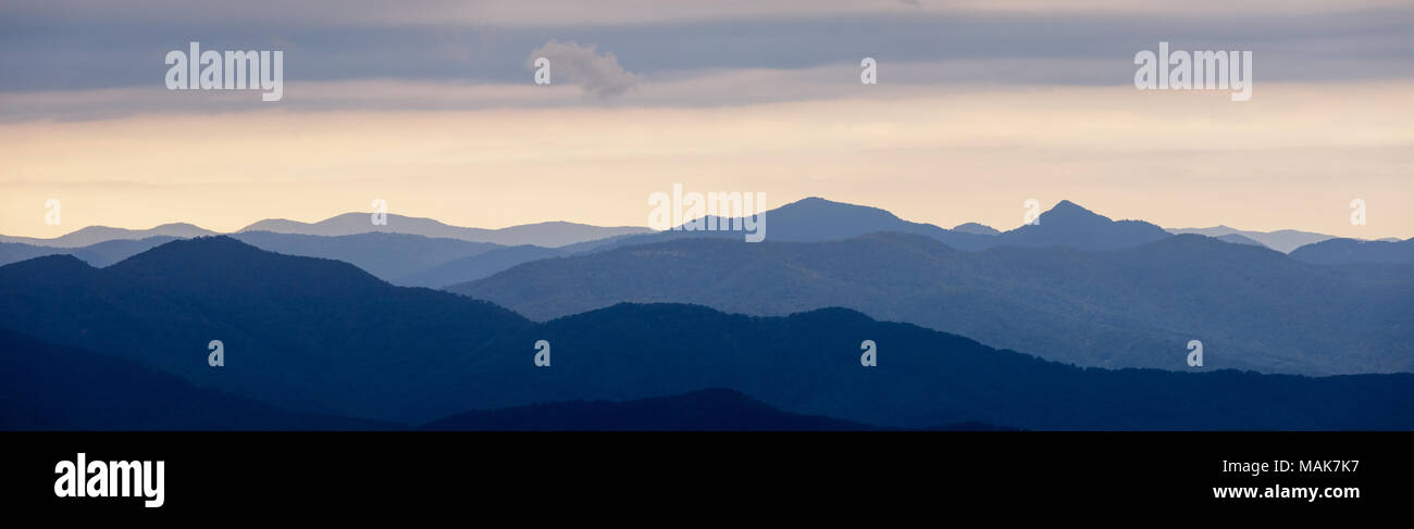 Mills River Overlook is on the Blue Ridge Parkway southwest of Asheville, North Carolina.  The eastern view looks over the Mills River Valley while the western view across the road looks northwest over the moutains of the Nantahala National Forest. - Stock Image