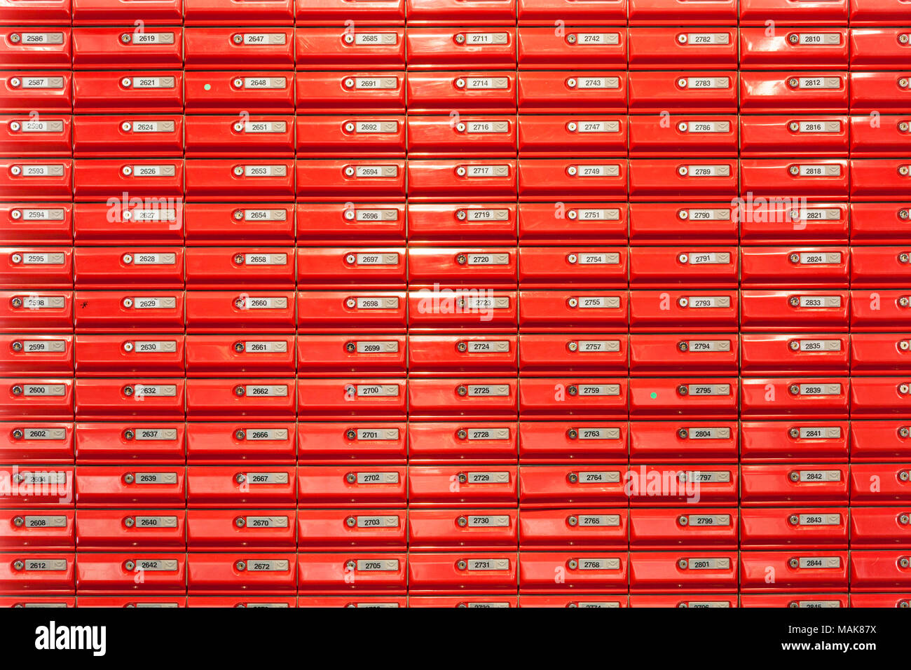 red mailboxes in post office lockable mail boxes wall mounted in a post office new zealand - Stock Image