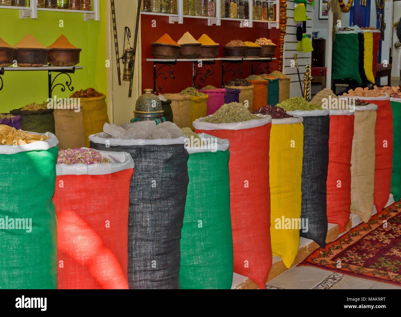MOROCCO MARRAKECH JEMAA EL FNA MEDINA SOUK ASSORTMENT OF SPICES IN COLOURED SACKS FOR SALE - Stock Image