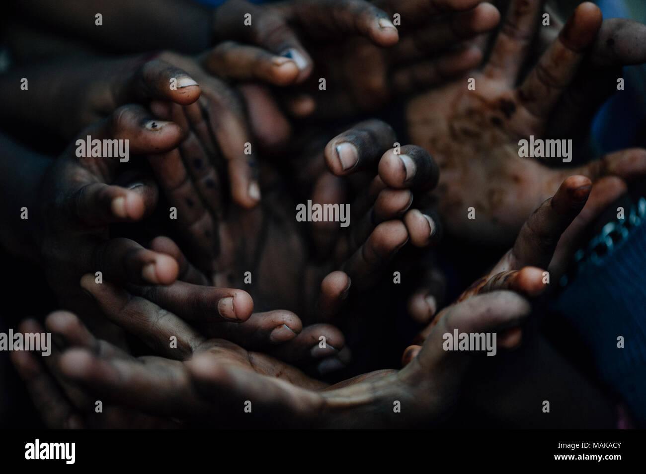 Hands of children in India - Stock Image