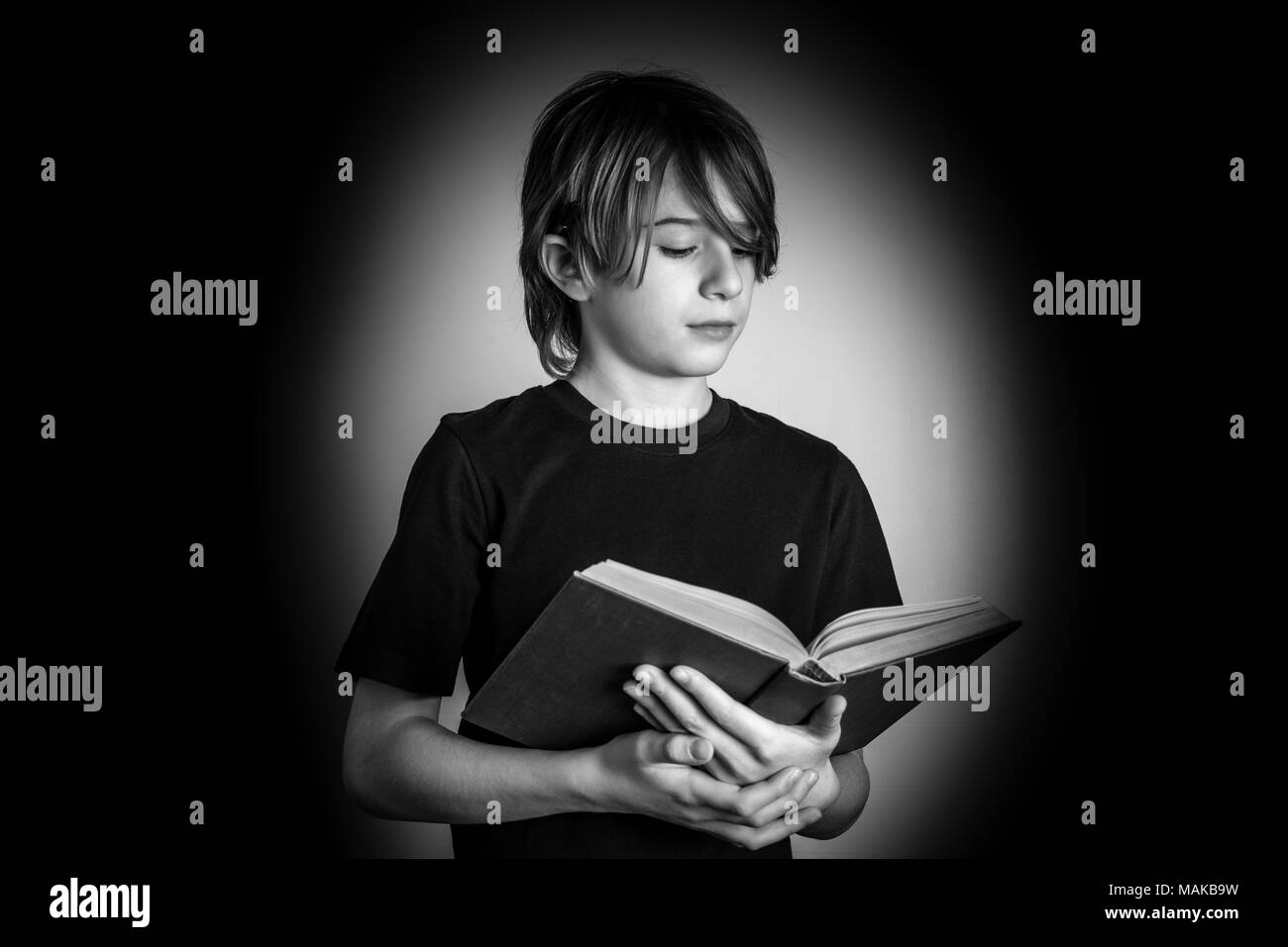young reader - black and white photo Stock Photo