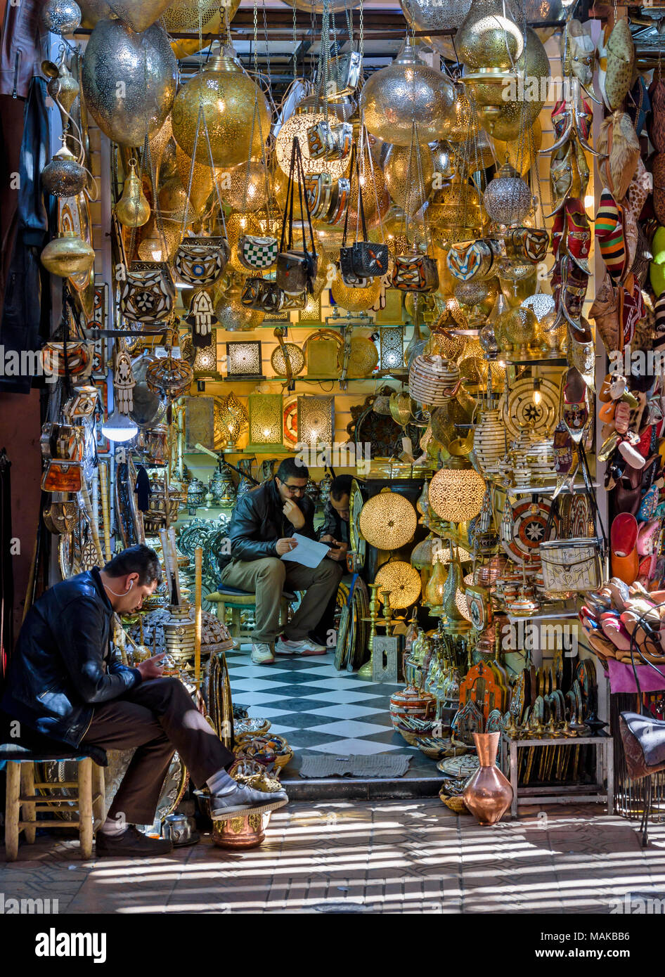 MOROCCO MARRAKECH JEMAA EL FNA MEDINA SOUK BRASS LIGHTS GLOBES INLAID TEAPOTS FOR SALE - Stock Image