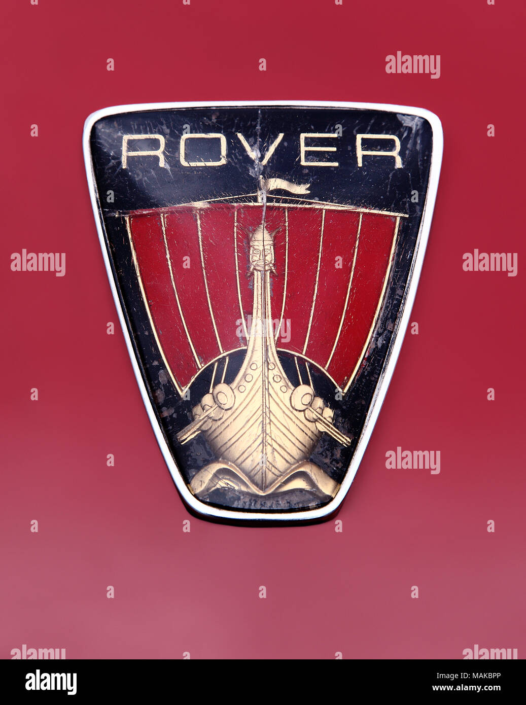 Rover viking ship logo, badge or hood ornament showing decades of wear and tear. - Stock Image
