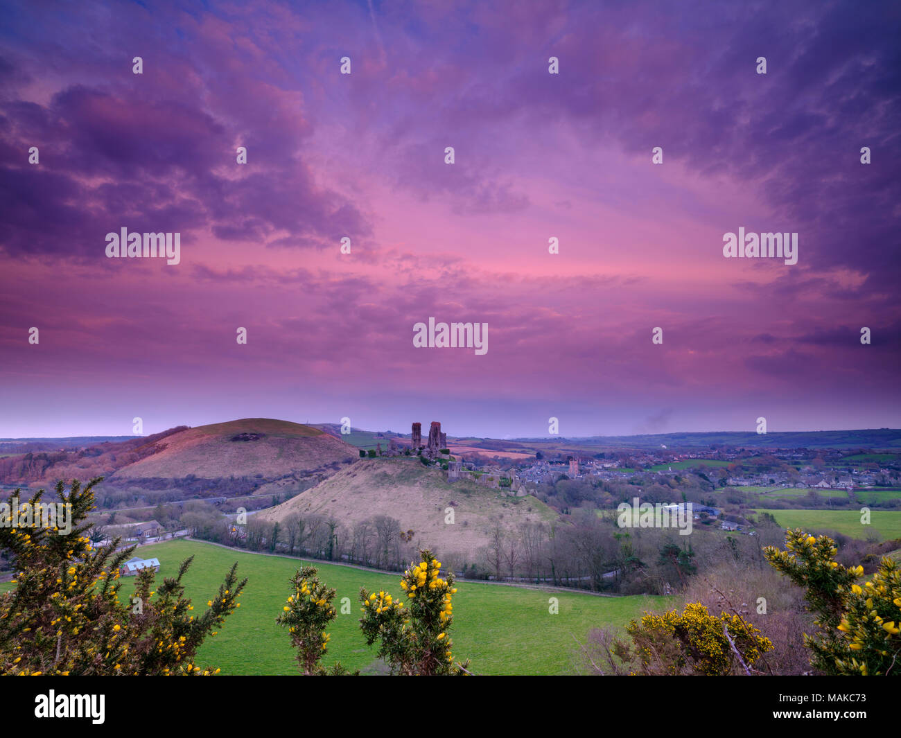 Spring sunset over Corfe Castle, Purbeck, Dorset, UK - Stock Image