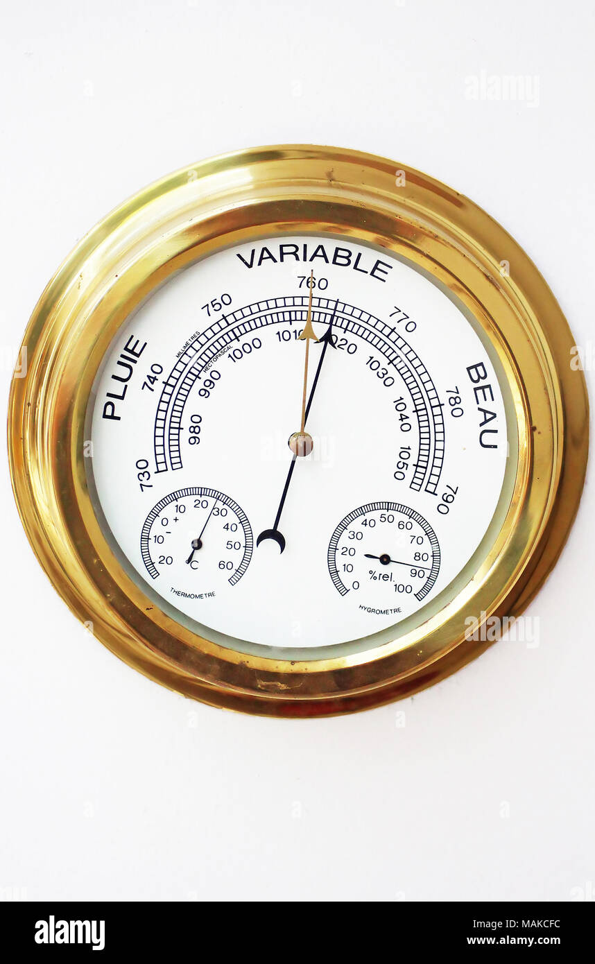 Brass Barometer, Thermometer, Hygrometer with White Face - Stock Image