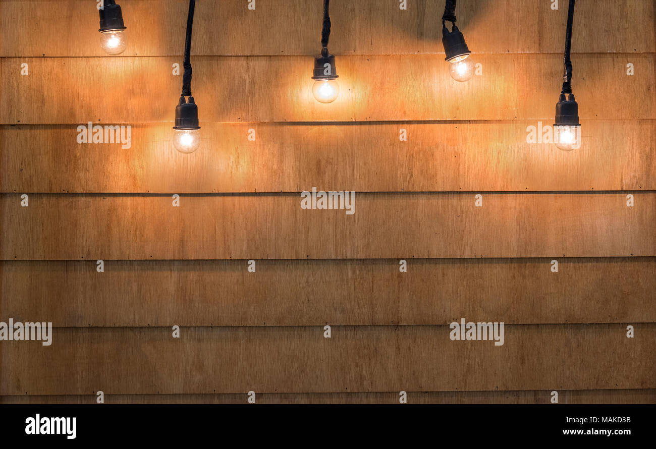 Light Bulbs Christmas On Wood Texture Background For Product Advertisement