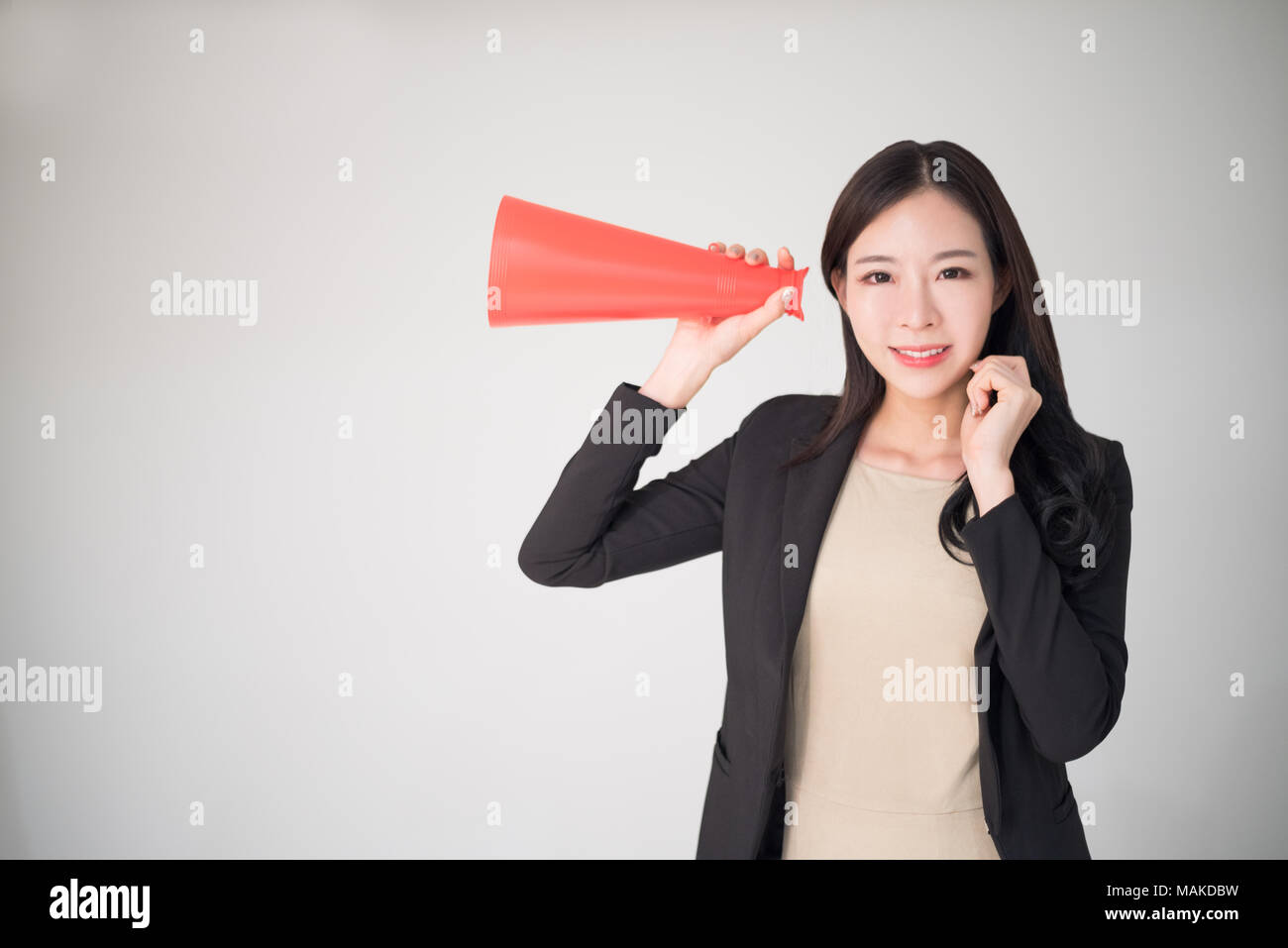 Feedback, Survey, Comment, Opinion concept background with asian woman hold red speaker cone. Customer feedback or comment and marketing survey is the - Stock Image