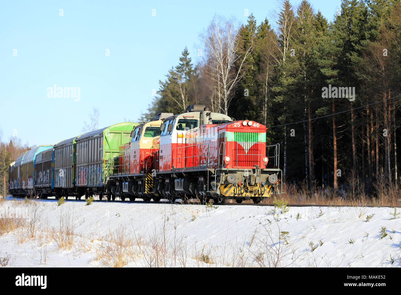 RAASEPORI, FINLAND - MARCH 16, 2018: Two diesel engines in front of freight train at speed in winter in South of Finland. - Stock Image