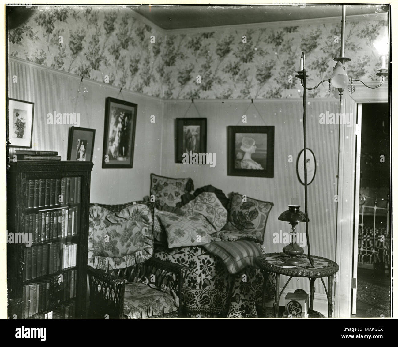 Horizontal Black And White Photograph Showing A Parlor