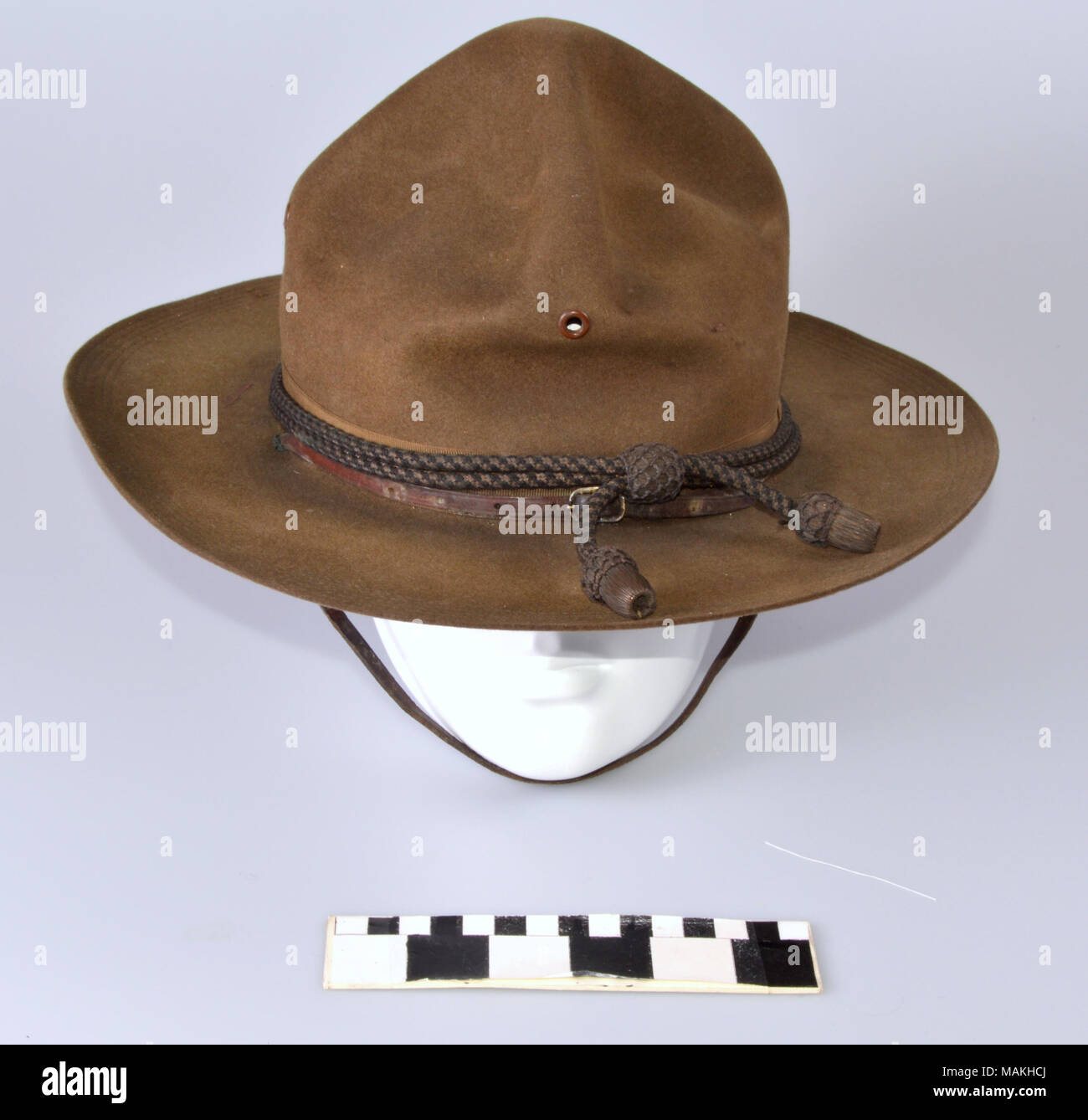 Olive drab Montana Peak military campaign hat. Tan felt hat with wide  circular brim and four pinched peaks on the crown. Hat cord around brim is  black and ... e9d2e3f54d1