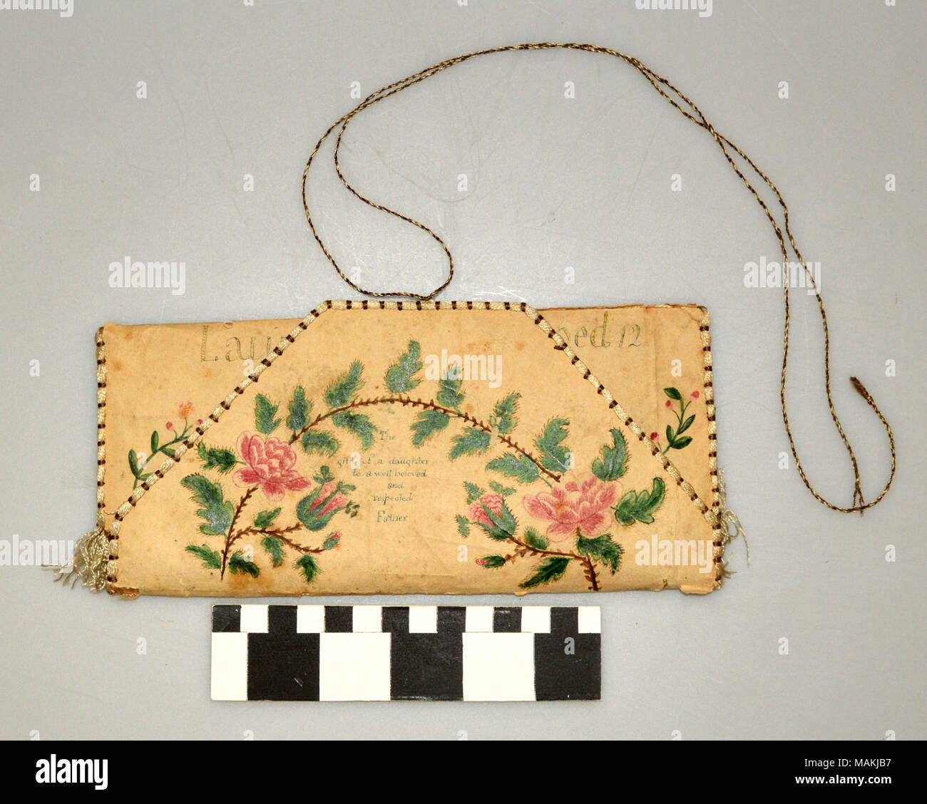 Paper wallet with fabric interior inscribed ' Laura A. Phelps aged 12 At Mrs Setons School, The gift of a daughter to a well beloved and respected Father. Title: Wallet Made by Laura A. Phelps for her Father  . 1815. Phelps, Laura A., 1803- - Stock Image
