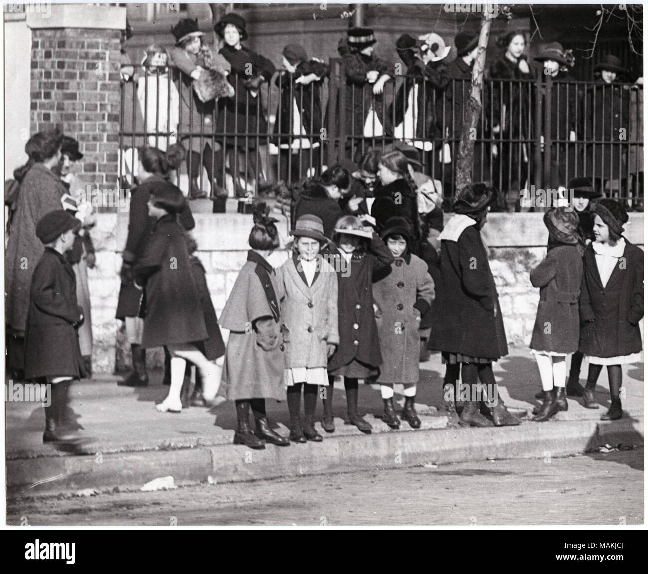 Horizontal black and white photograph showing children outside washington school at 1131 euclid avenue near fountain avenue the foreground shows children