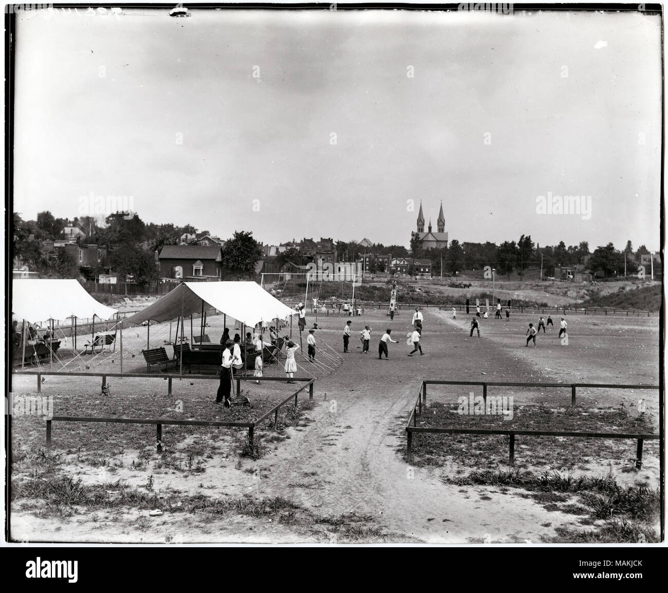 Horizontal Black And White Photograph Showing Children Playing At