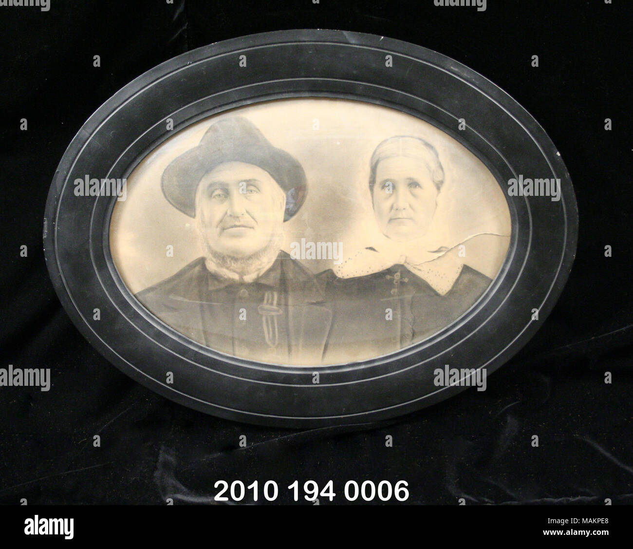 Photograph Of Vohs Family In Oval Wooden Frame Painted Black Convex