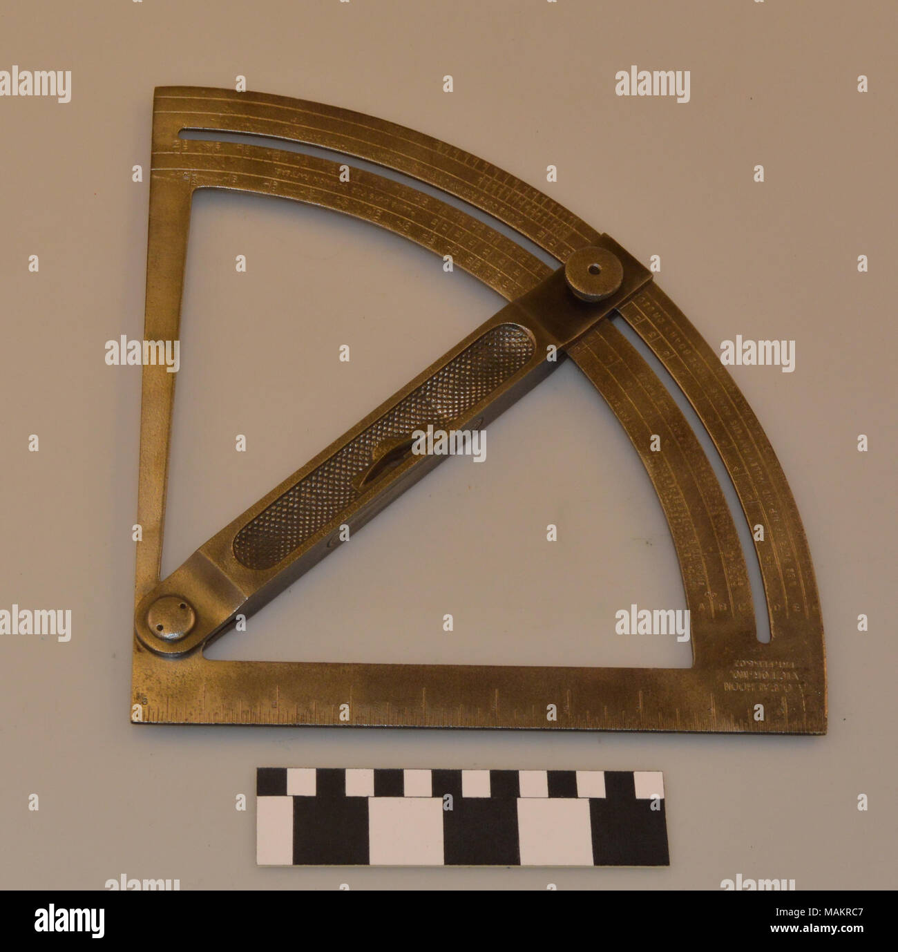 Rafter polygon bevel gauge patented by A. O. Calhoon in Victor, Missouri. Title: A.O. Calhoon Rafter and Polygon Bevel Gauge  . between 1907 and 1920. Calhoon, Albert Odell, 1852-1921 - Stock Image