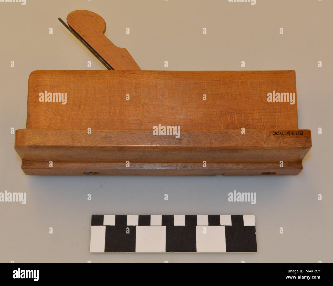 Double coping plane with an ovolo section and right angle fence screwed into sole, made by Abel R. Earl in St. Louis, Missouri. Title: Molding Plane Made by Abel R. Earl  . between 1850 and 1869. Earl, Abel R. - Stock Image