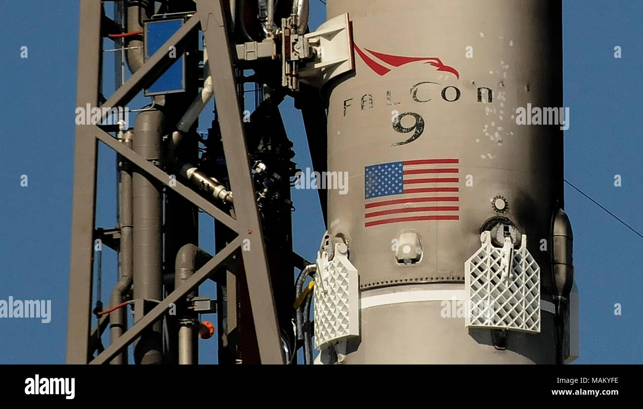 Cape Canaveral, Florida, United States. April 2, 2018 - A SpaceX Falcon 9 rocket stands ready for launch on April 2, 2018 at launch complex 40 at Cape Canaveral Air Force Station in Florida. The rocket is carrying a Dragon spacecraft containing 5,800 pounds of supplies for the International Space Station (ISS). This is the 14th ISS resupply mission by SpaceX for NASA. (Paul Hennessy/Alamy) Credit: Paul Hennessy/Alamy Live News - Stock Image