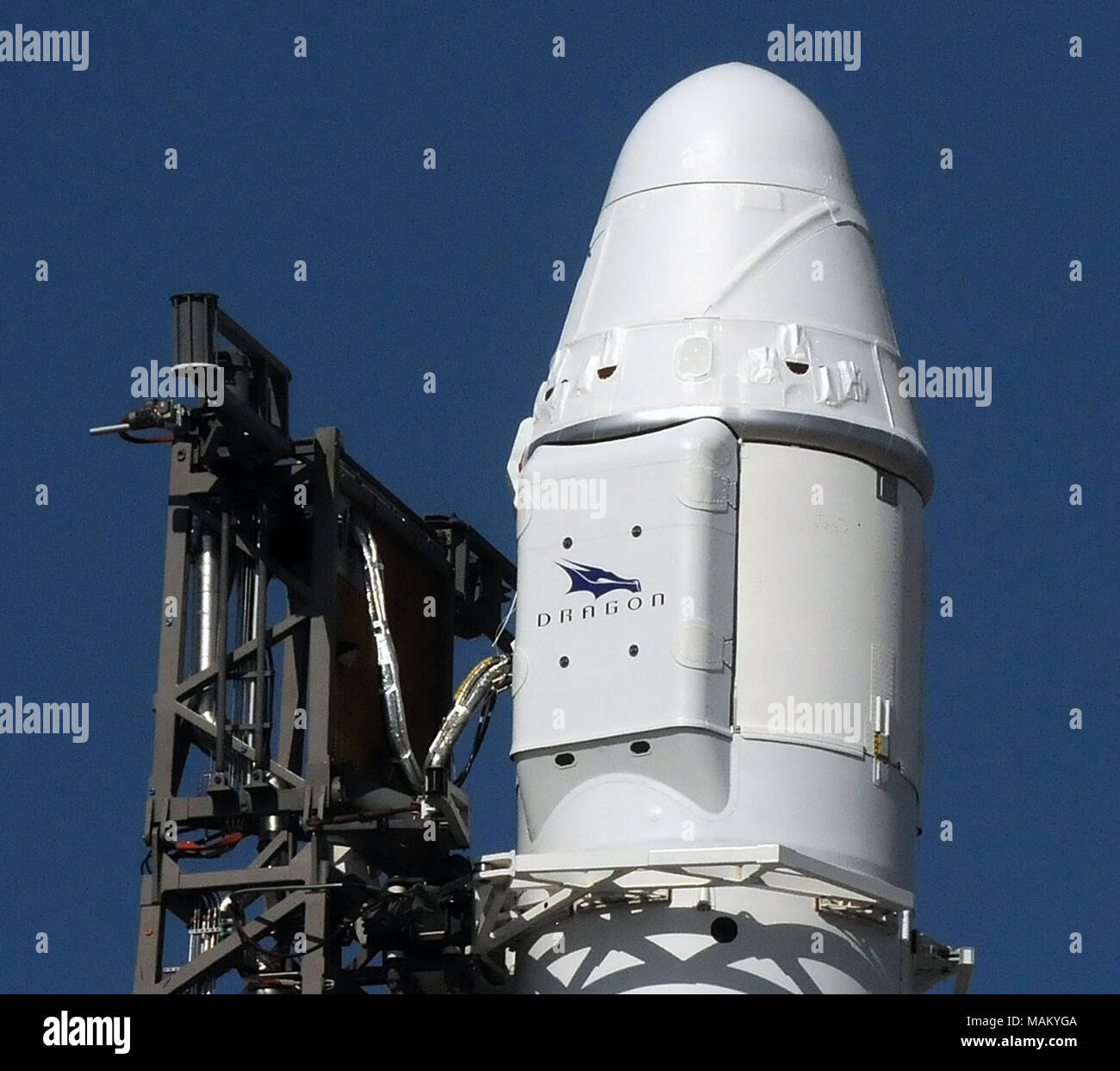 Cape Canaveral, Florida, United States. April 2, 2018 - A Space X Dragon spacecraft is seen as it sits atop a Falcon 9 rocket before launch on April 2, 2018 at launch complex 40 at Cape Canaveral Air Force Station in Florida. The Dragon spacecraft contains 5,800 pounds of supplies for the International Space Station (ISS). This is the 14th ISS resupply mission by SpaceX for NASA. (Paul Hennessy/Alamy) Credit: Paul Hennessy/Alamy Live News - Stock Image