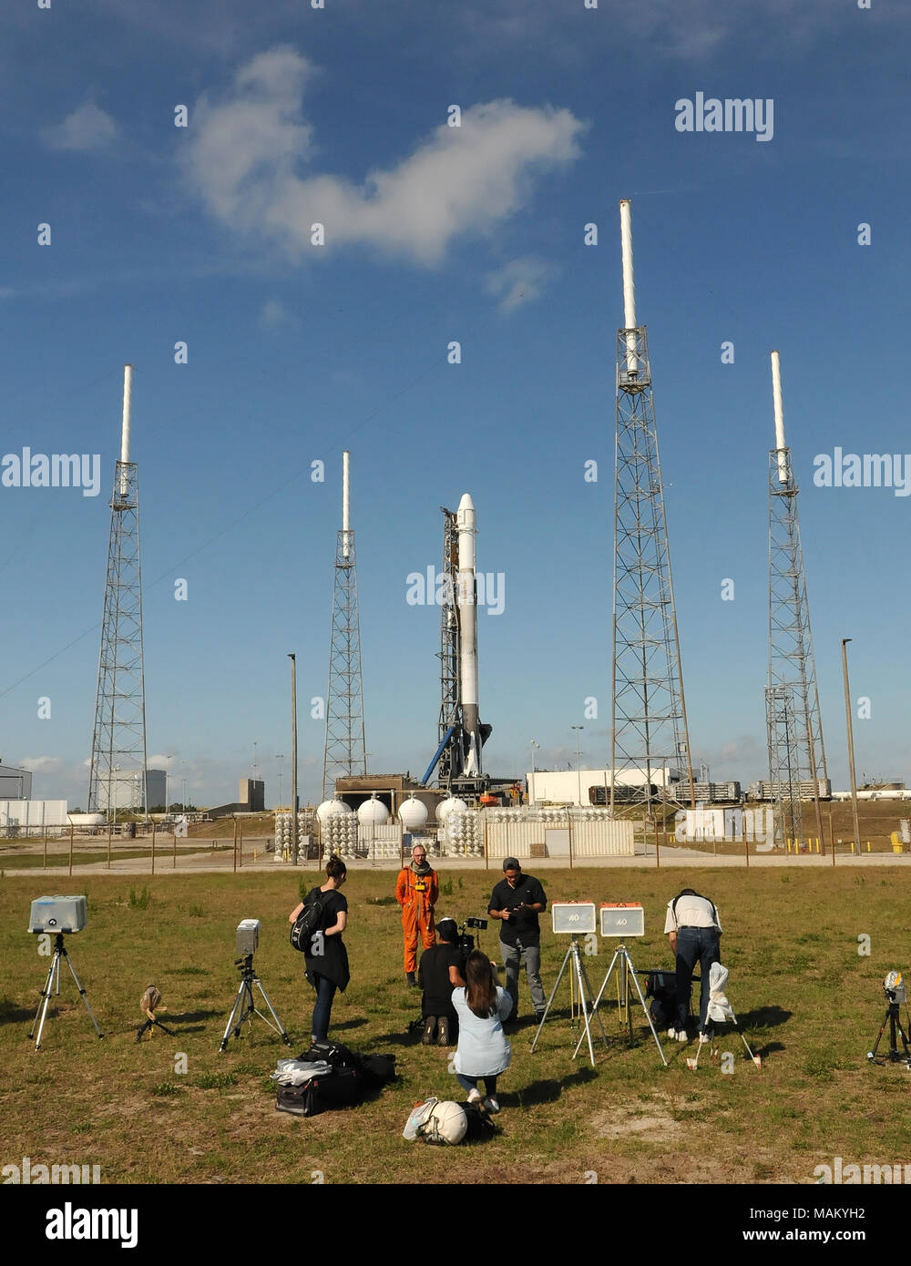 Cape Canaveral, Florida, United States. April 2, 2018 - Members of the media photograph a SpaceX Falcon 9 rocket as it stands ready for launch on April 2, 2018 at launch complex 40 at Cape Canaveral Air Force Station in Florida. The rocket is carrying a Dragon spacecraft containing 5,800 pounds of supplies for the International Space Station (ISS). This is the 14th ISS resupply mission by SpaceX for NASA. (Paul Hennessy/Alamy) Credit: Paul Hennessy/Alamy Live News - Stock Image