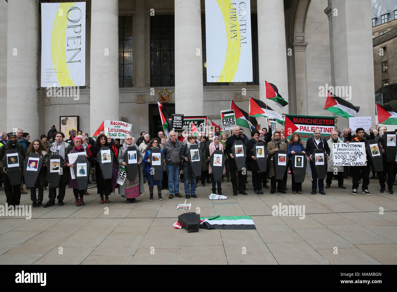 Manchester, UK. 3rd April, 2018. The Palestine Solidarity Campaign and supporters of Palestine hold a vigil after the recent killing and injuries of Palestiians during a protest near the Gaza border.  Coffins representing the children killed in the conflict are held up at the vigil, St Peters Square, Manchester, 3rd April, 2018 (C)Barbara Cook/Alamy Live News - Stock Image