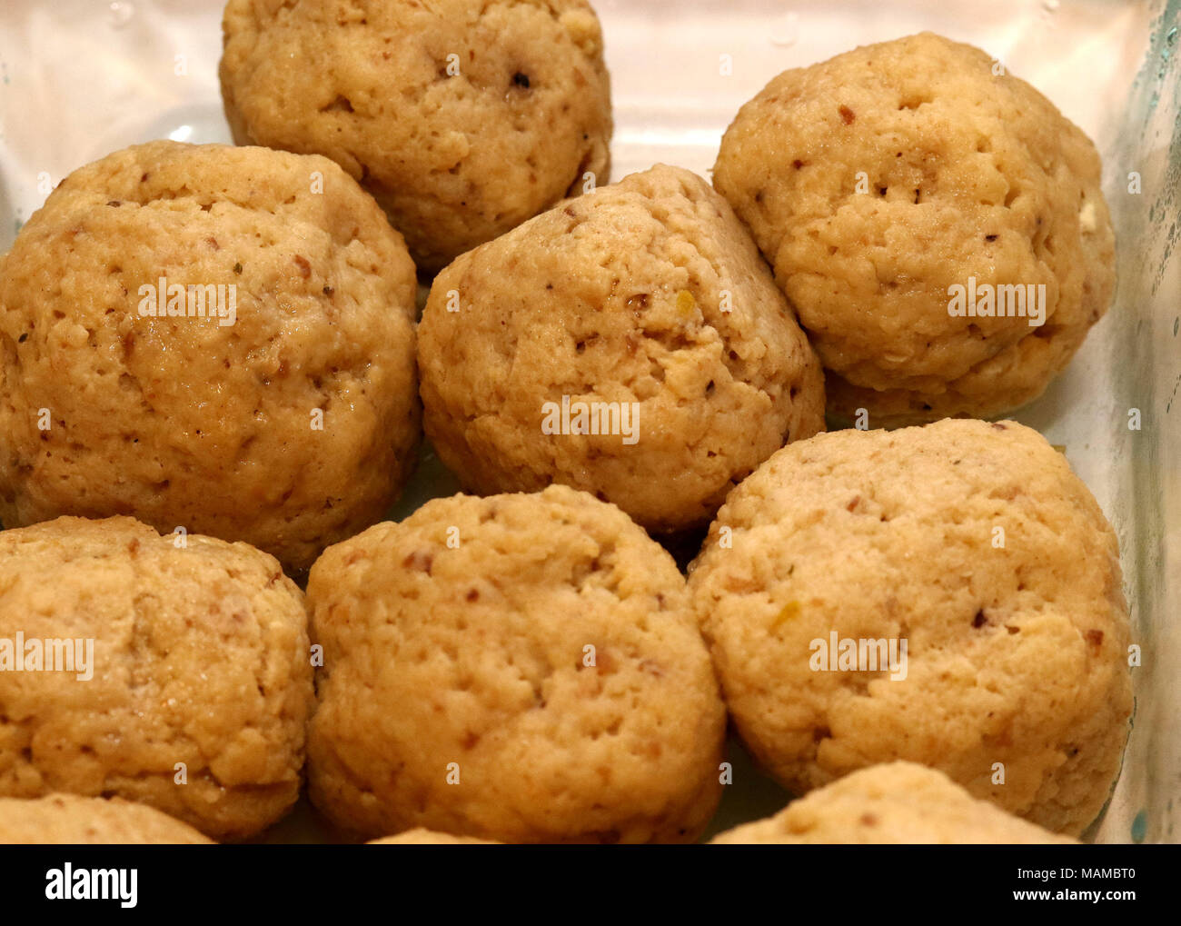 Matzah balls in a dish - Stock Image