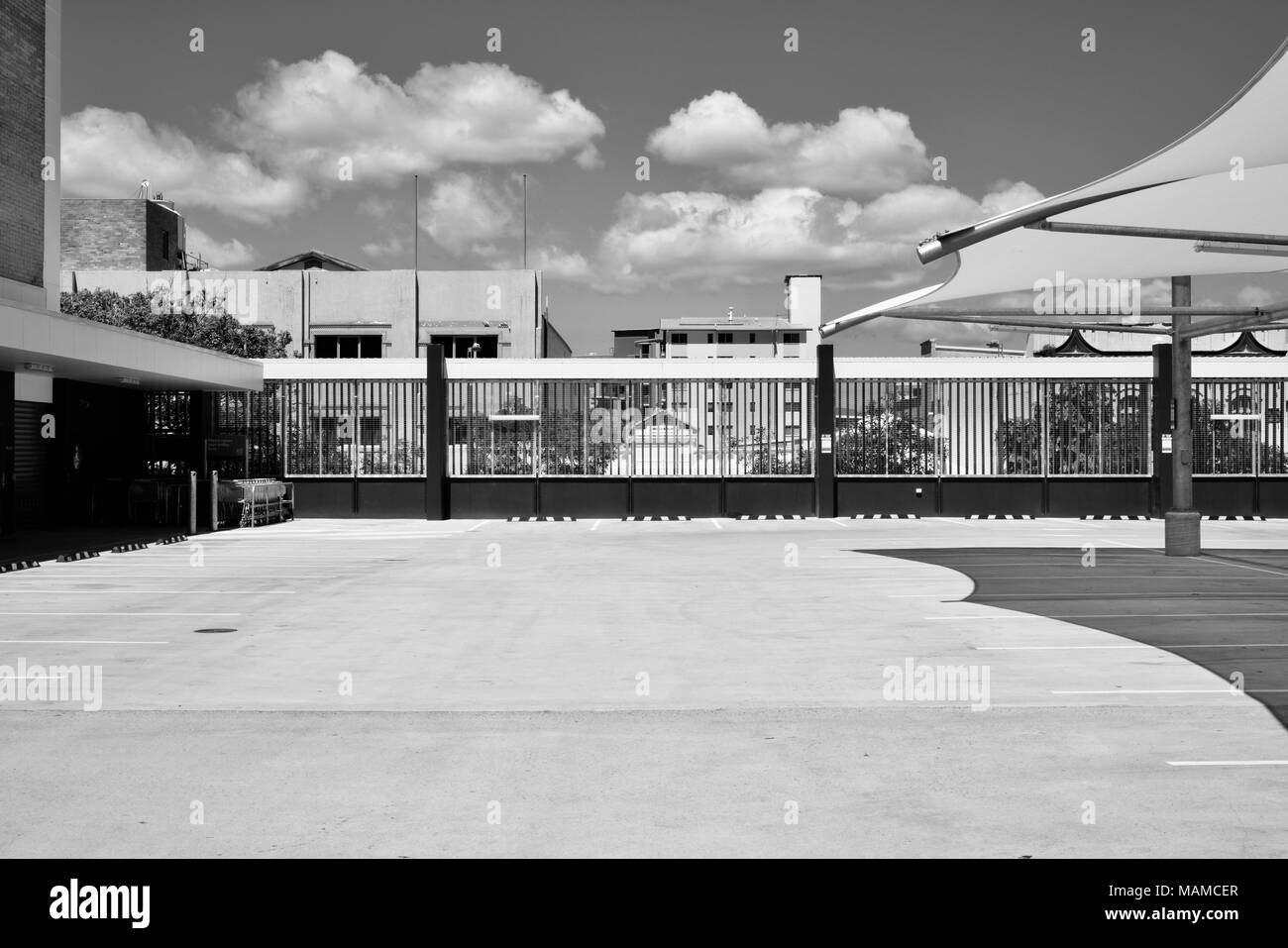 Car park near woolworths set in black and white desolate and cold feel with a warmth, City lane off flinders street in Townsville Queensland Australia - Stock Image