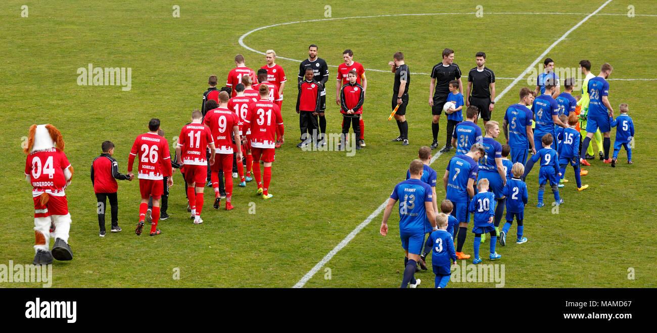 sports, football, Regional League West, 2017/2018, Rot Weiss Oberhausen vs Wuppertaler SV 1:1, Stadium Niederrhein in Oberhausen, teams come in, running-in kids - Stock Image