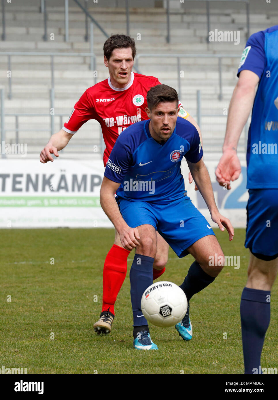 sports, football, Regional League West, 2017/2018, Rot Weiss Oberhausen vs Wuppertaler SV 1:1, Stadium Niederrhein in Oberhausen, scene of the match, Gino Windmueller (WSV), behind Robert Flessers (RWO) - Stock Image