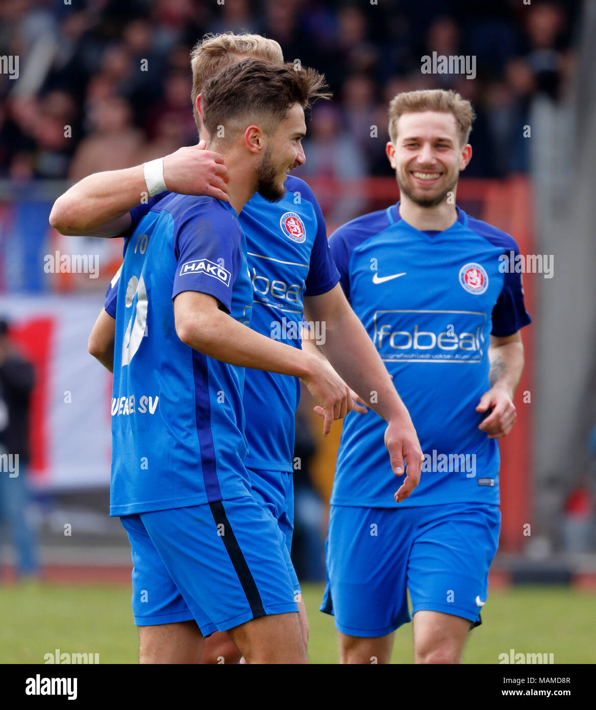 sports, football, Regional League West, 2017/2018, Rot Weiss Oberhausen vs Wuppertaler SV 1:1, Stadium Niederrhein in Oberhausen, rejoicing at the 1:1 equalizer, left goal scorer Enes Topal (WSV), right Dennis Dowidat (WSV) - Stock Image