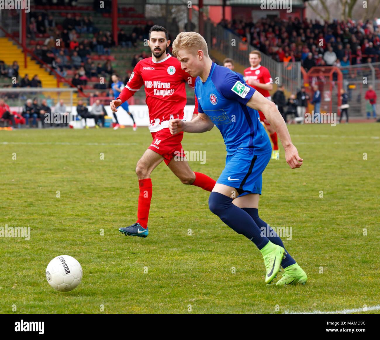 sports, football, Regional League West, 2017/2018, Rot Weiss Oberhausen vs Wuppertaler SV 1:1, Stadium Niederrhein in Oberhausen, scene of the match, Niklas Heidemann (WSV) in ball possession, behind Rafael Garcia (WSV) - Stock Image