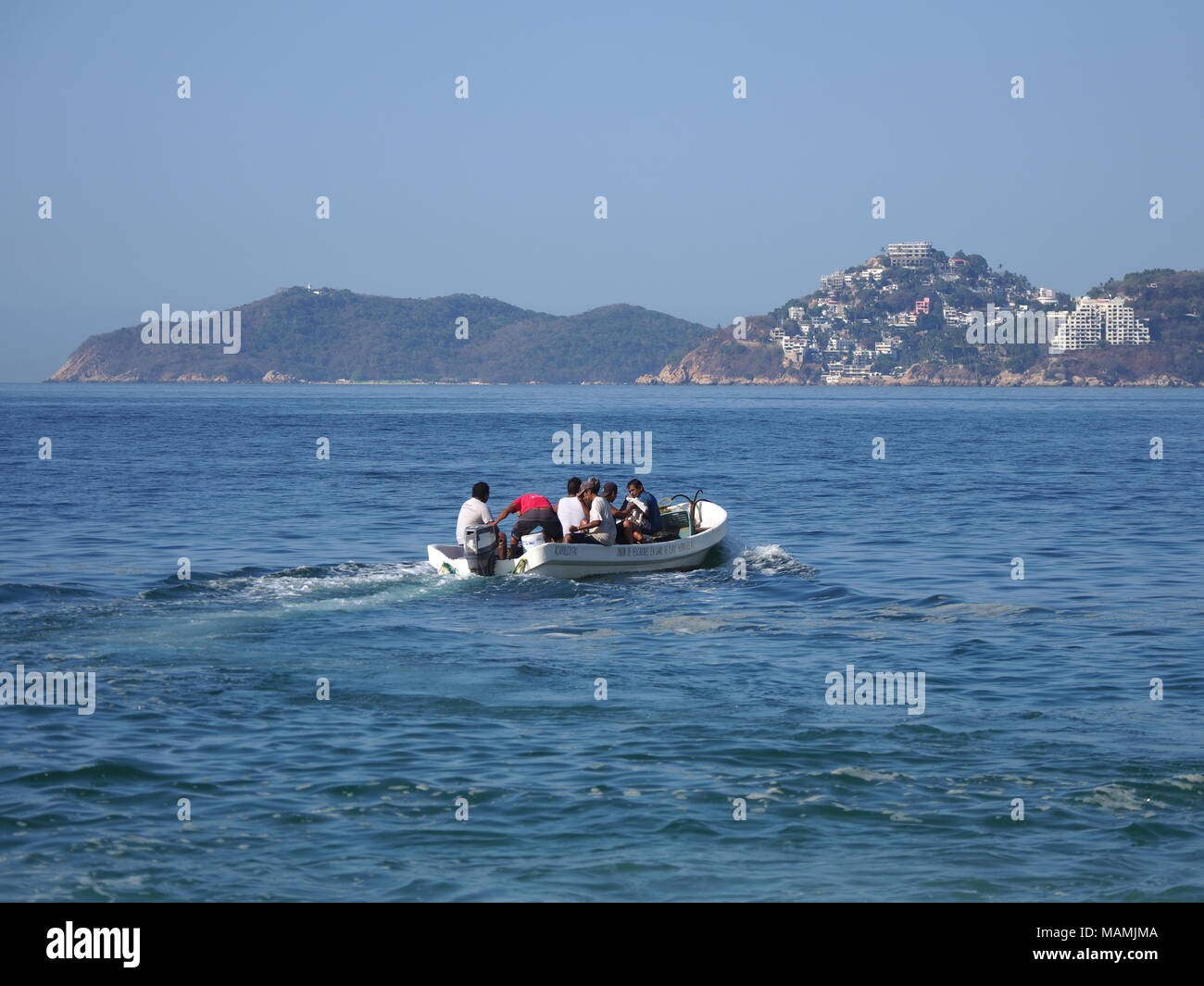 Motor boat used for fishing and tourist excursions of Pacific Ocean in ACAPULCO in MEXICO, bay landscape Stock Photo