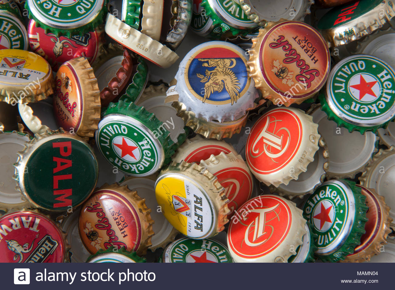 Generic 21-tooth crown cork bottle cap from various Dutch and Belgian beer brands. - Stock Image