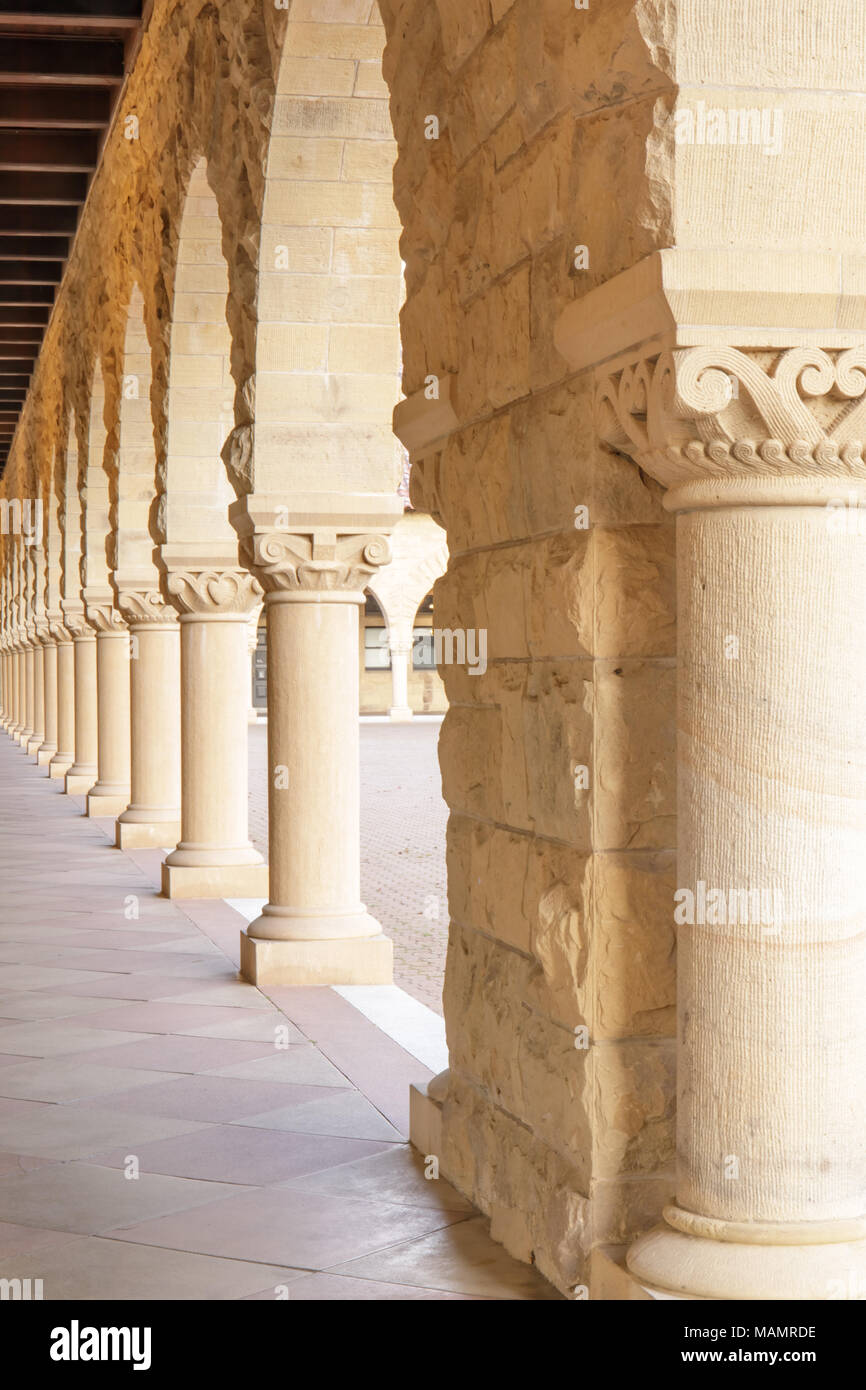 Stanford, California - March 28, 2018: Exterior colonnade hallway of Stanford University Campus Building - Stock Image