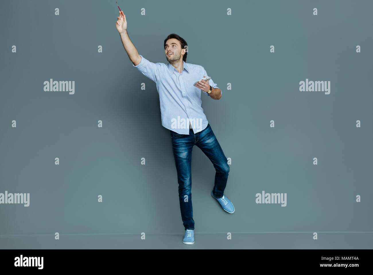 Smart talented man expressing his feelings - Stock Image