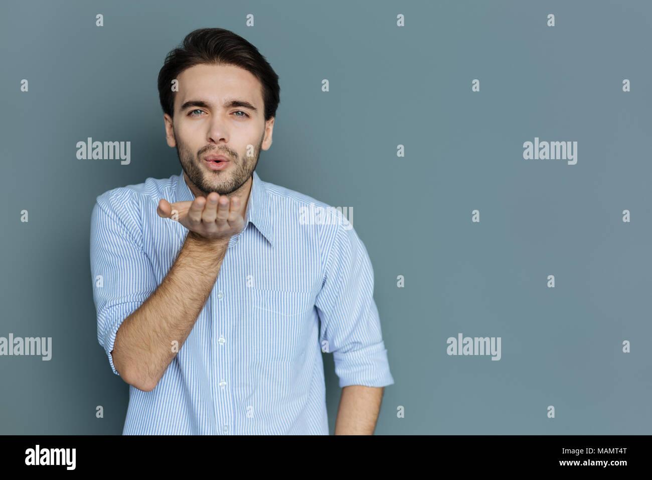Pleasant nice man sending you a kiss - Stock Image