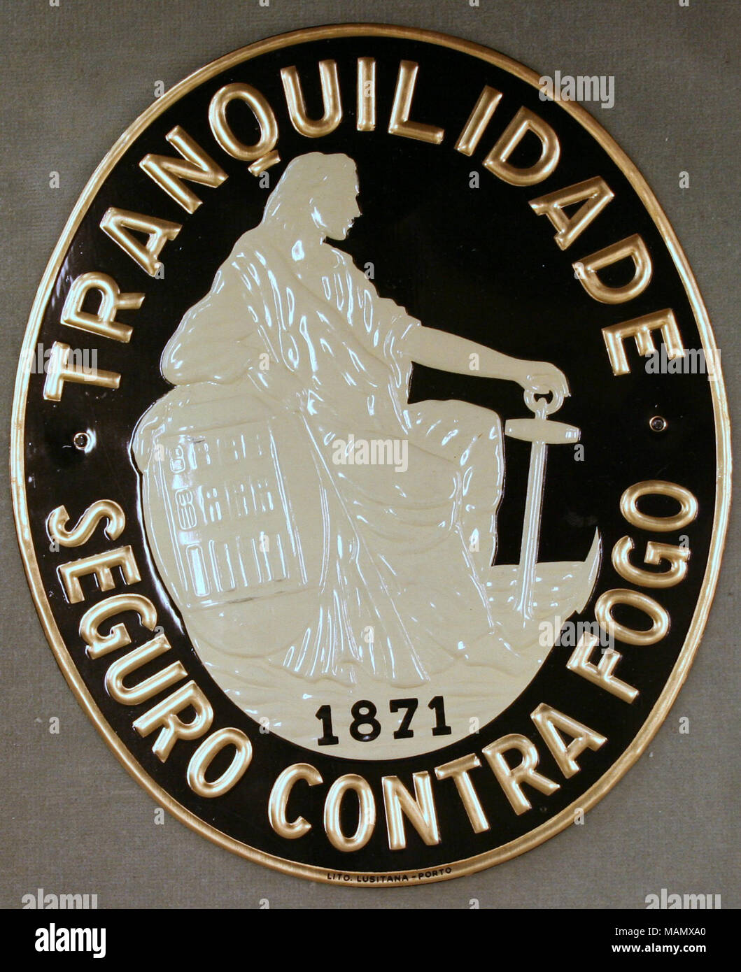 Tranquilidade Portuense In Porto Portugal Showing Raised Ivory Figure Seated And Company Name Gold Lettering Around Edge Title Fire Mark For