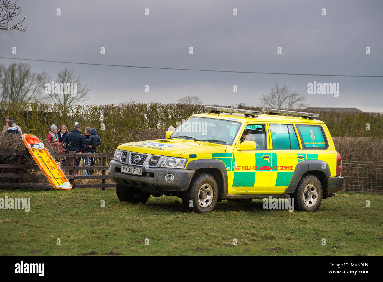 Ambulance and stretcher on standby to assist injured participants in the annual tussle of villagers from Hallaton with rival villagers from the nearby - Stock Image