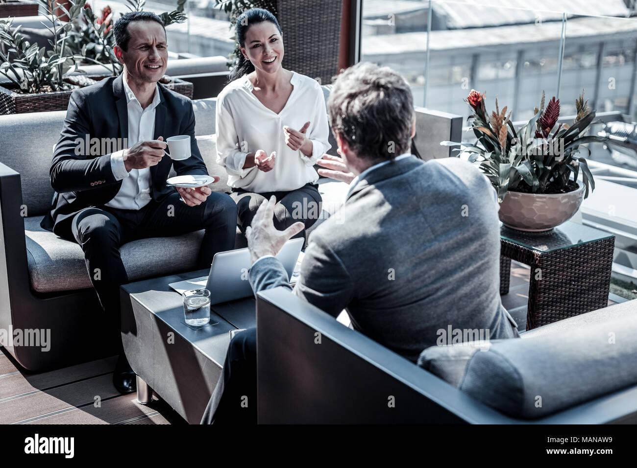 Positive nice businesspeople talking - Stock Image