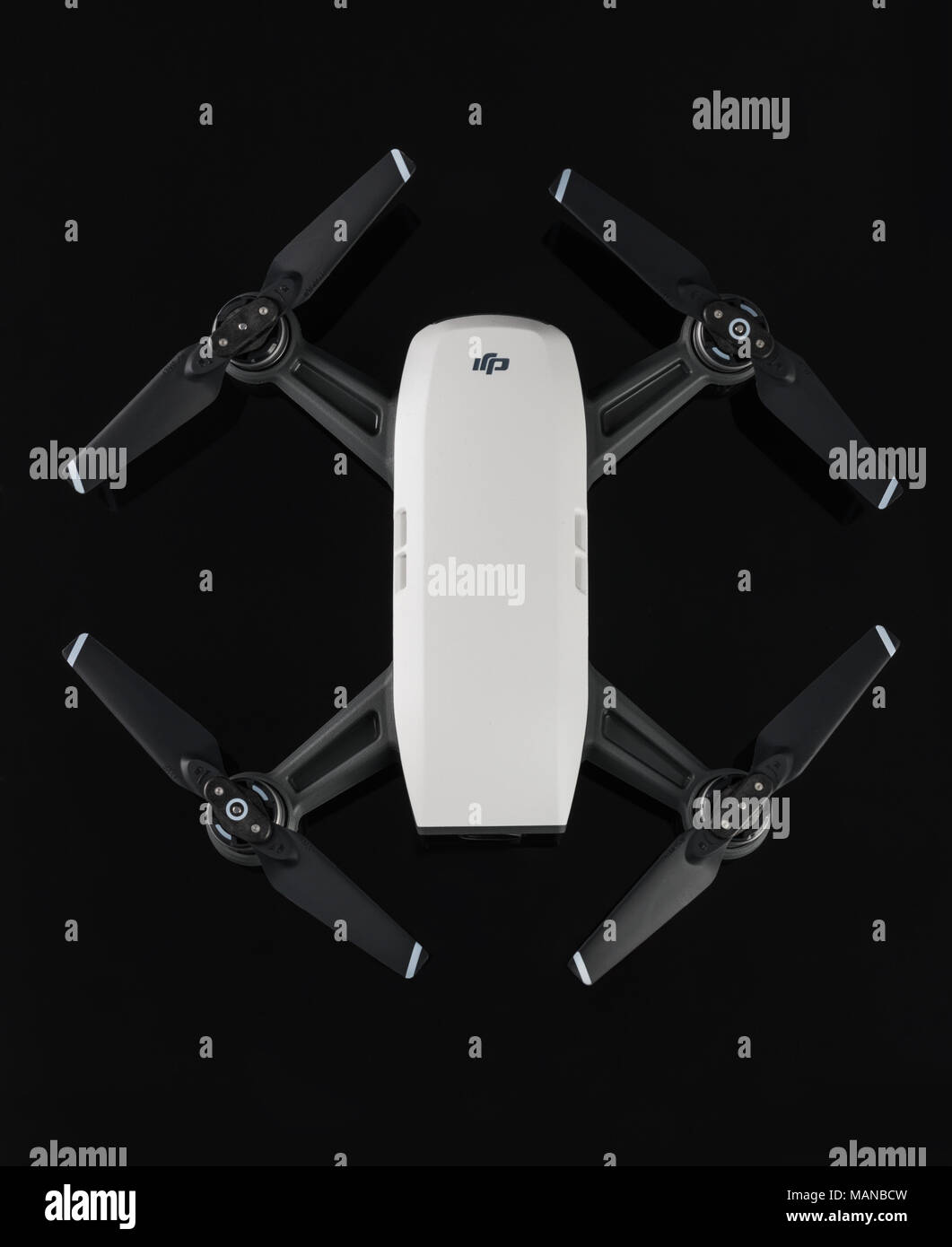 Varna, Bulgaria - February 14 ,2018: Flying drone quadcopter Dji Spark is mini drone that features all of DJI's signature technologies, isolated on bl - Stock Image